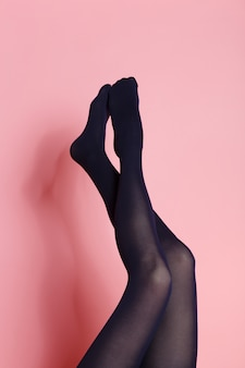 Legs of young caucasian woman in black tights