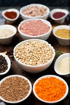 Legumes and spices in white bowls