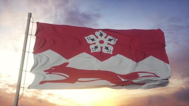 レスターシャーの旗、イギリス、風、空、太陽の背景に手を振っています。 3dレンダリング