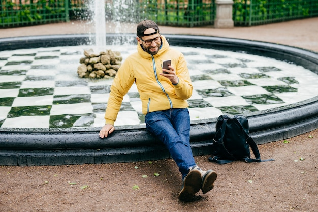 Leisure and free time concept. portrait of carefree man with beard dressed in casual clothes