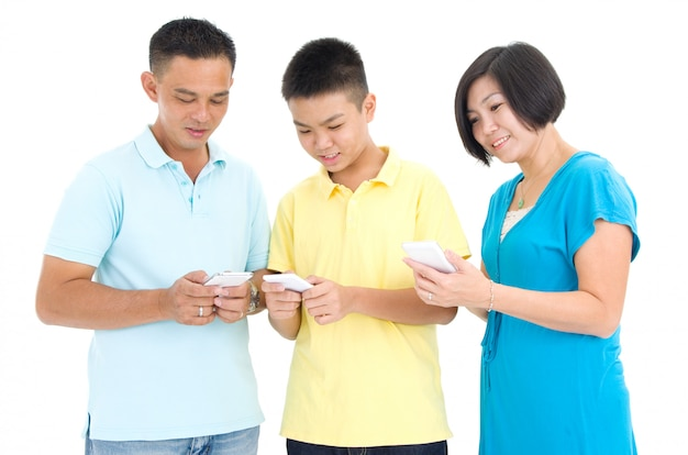 Leisure, technology, technology, family and people concept - parent and son with smartphones