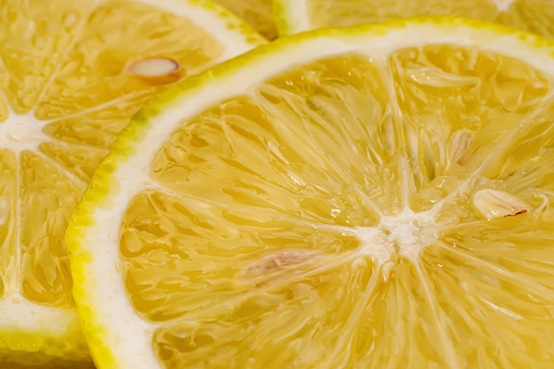 レモンの背景。レモンスライスのクローズアップビュー。