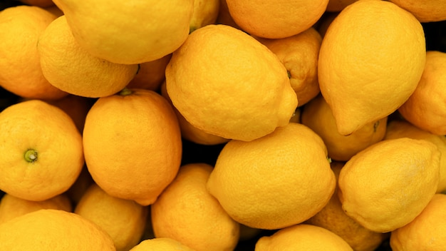 Lemon background . colorful display of lemons in market