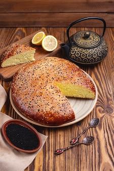 Lemon cake sesame tea pot side view