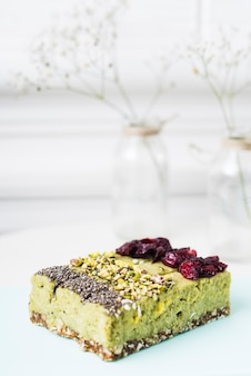 Lemon cake slices with chia seeds; pistachios and dried cranberries toppings