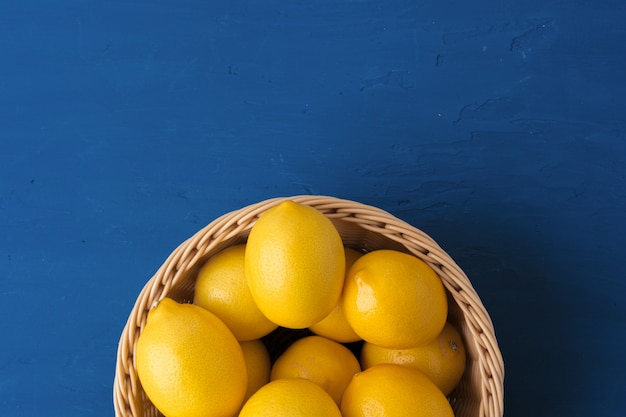 Lemon on classic blue background, top view