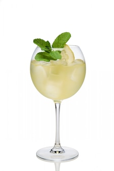 Lemon cocktail with a sparkling wine with ice cubes in wine glass isolated on white