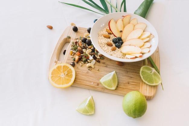 Lemon; dryfruits and oatmeals on white background