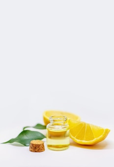 Lemon essential oil on a white isolated background. selective focus. food.