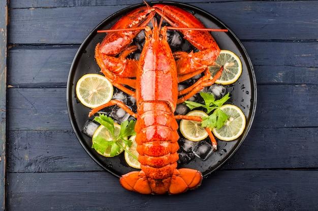 Lemon and fresh boston lobster on the ice