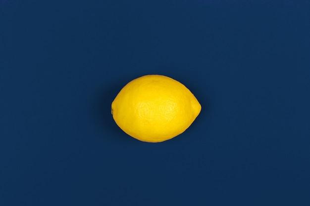 Lemon fruit on classic blue background top view