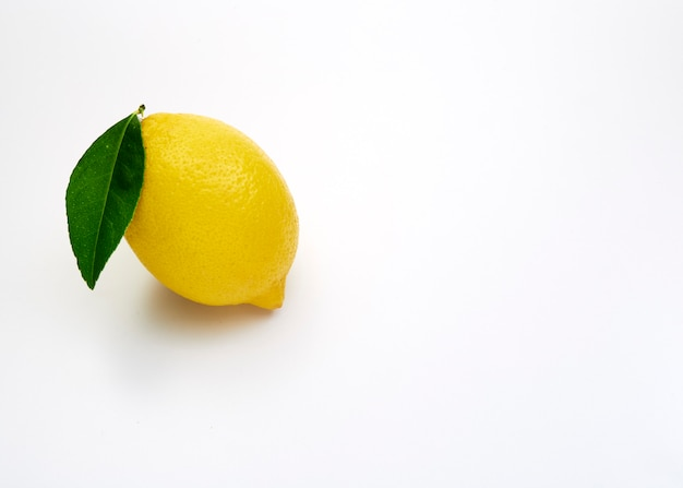 Lemon fruit with leaf on white
