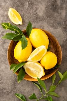 Lemon fruits, in wooden bowl.