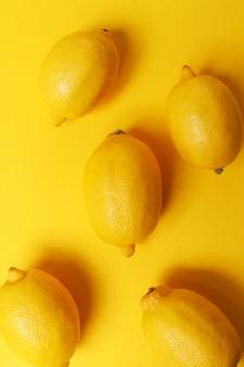 Lemon isolated on yellow surface