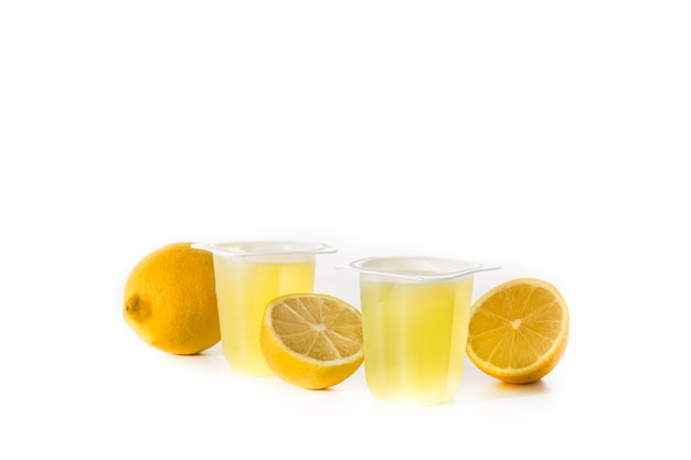 Lemon jellies on a plastic cup isolated on white surface