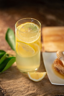 Lemon juice with honey on wooden table