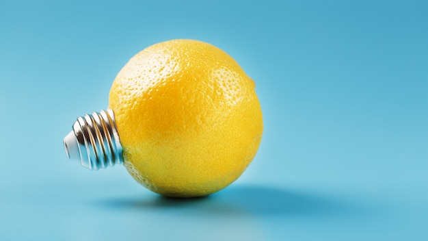 Lemon light bulb on a blue background