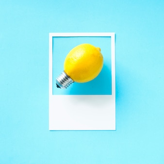 A lemon light bulb in a frame
