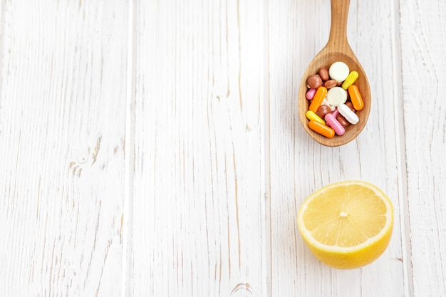 Lemon and lots of pills and vitamins.