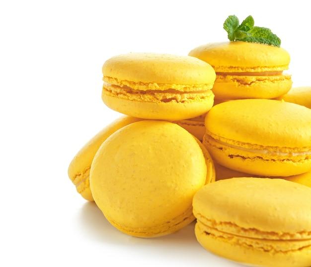 Lemon macarons on white