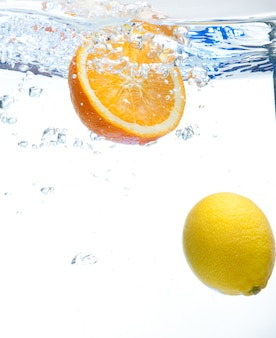 Lemon and orange in the water