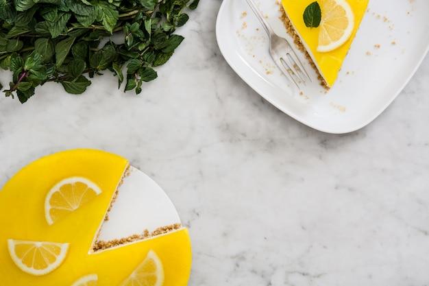Lemon pie slice on white marble top view