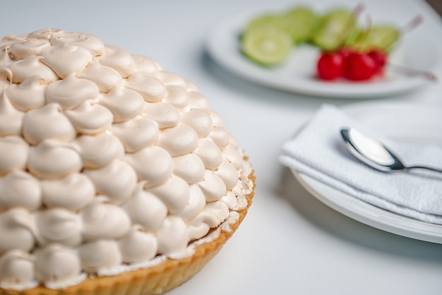 Lemon pie with fruits and a spoon