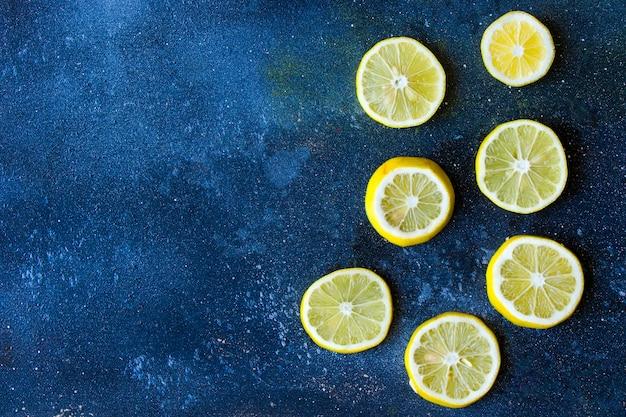 Lemon rings on the blue table, chopped lemon