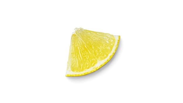 Кусочек лимона на белом фоне. фото высокого качества