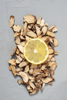 Lemon slice on organic wood bark background