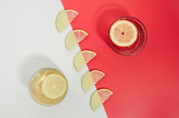 Lemon slices and juice on table