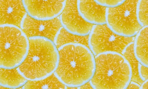 レモンスライスのシームレスな背景。黄色い柑橘系の果物を切ります。