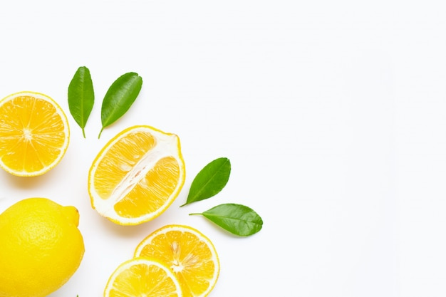 Lemon and slices with leaves isolated on white background