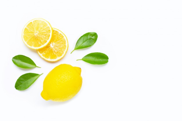 Lemon and slices with leaves isolated on white. copy space