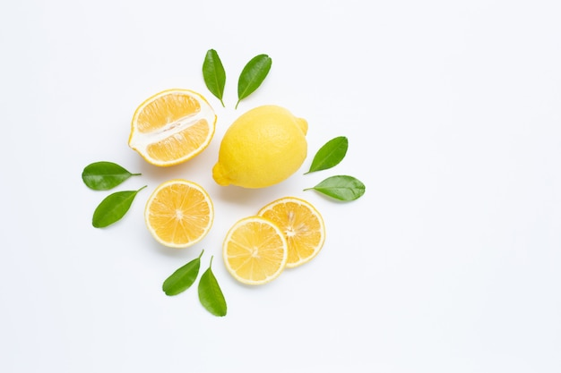 Lemon and slices with leaves isolated on white