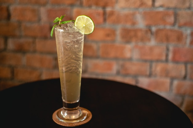 Lemon soda beverage for summer with brick wall background