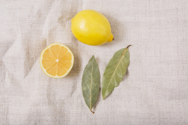 The lemon and spices on the woven tablecloth.