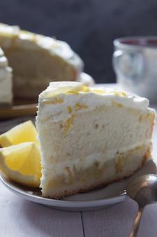Lemon sponge cake with cream and zest macro