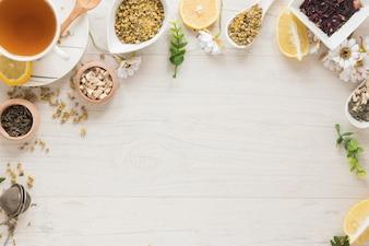 Lemon tea; dried chinese chrysanthemum flowers; herbs on wooden desk