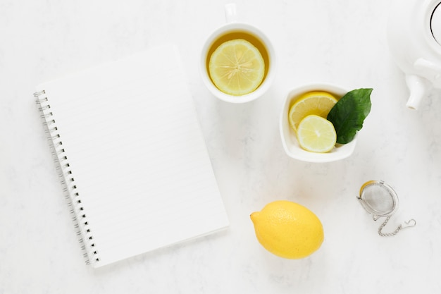 Lemon tea with blank notebook