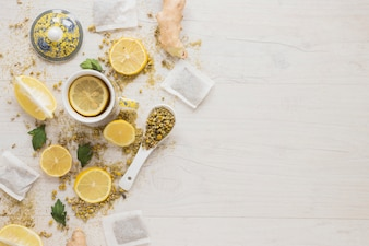 Lemon tea with dried chinese chrysanthemum flowers and lemon slices on wooden table