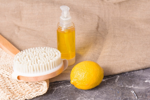 Lemon, wooden brush with natural bristles for dry massage against cellulite, body scrub, home soap