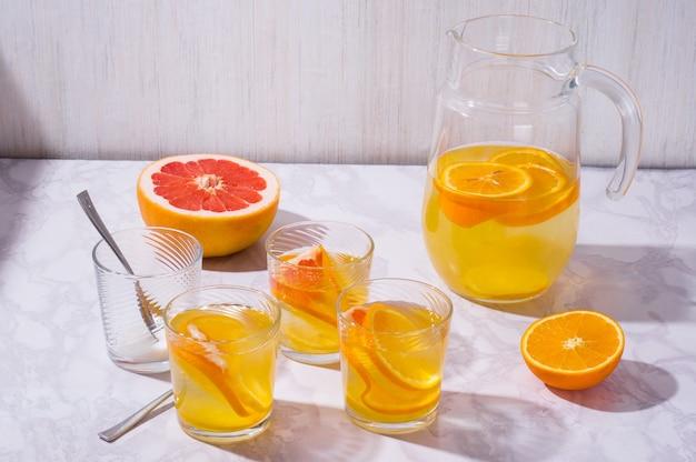 Lemonade drink with fresh orange lemon and grapefruit lemon cocktail with juice citrus lemonade in glass jur refreshing summer drink
