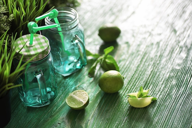 Lemonade from lime and mint in a glass jar on a table