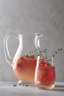 Lemonade with grapefruit. refreshing decanter and glass of orange lemonade