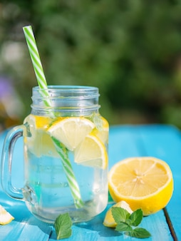 Lemonade with lemon and mint in a glass jar