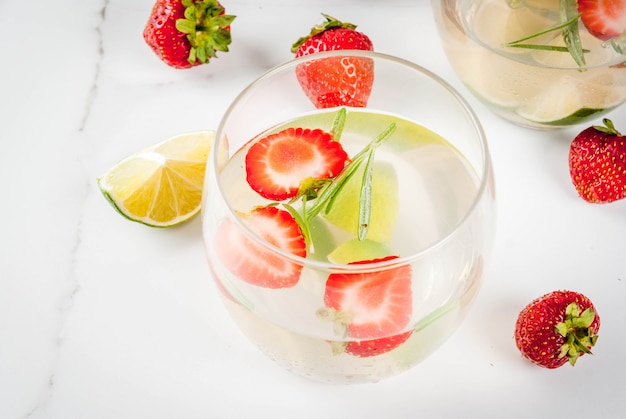 Lemonade with lime, fresh strawberries and rosemary