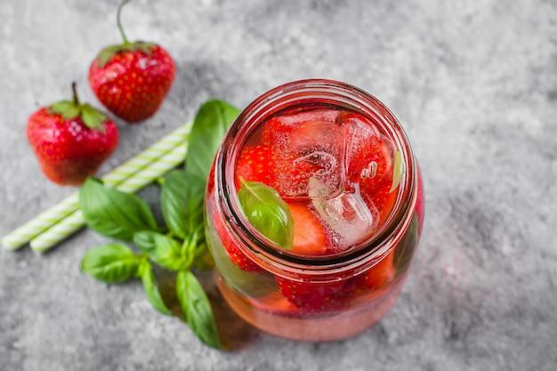 Lemonade with strawberry and basil in mason jar