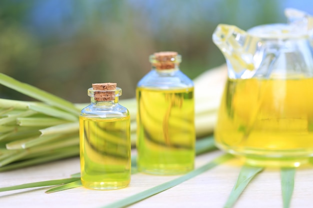 Lemongrass essential oil in glass bottles