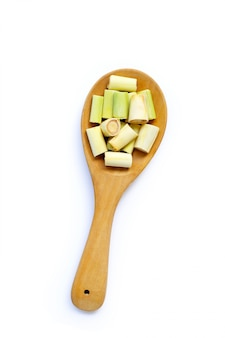 Lemongrass slices on wooden spoon on white isolated